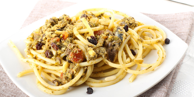 Pasta with fresh sardines and fennel on complex background
